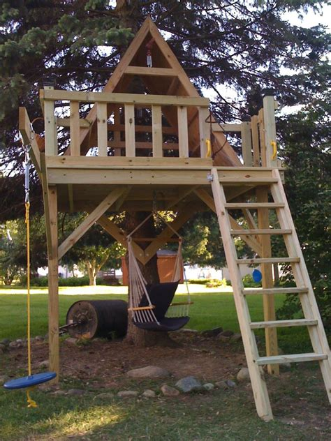 backyard treehouse ideas elements to include in a kid s treehouse to make it awesome