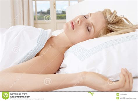 woman on woman in bed young woman sleeping in bed stock image image 29591639