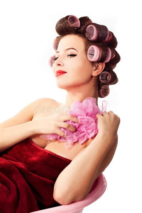 bathtub pinup woman wearing haircurlers relaxing in pink bathtub pinup