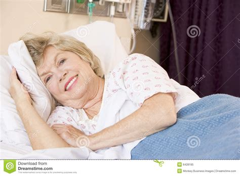 woman in hospital bed senior woman lying in hospital bed royalty free stock