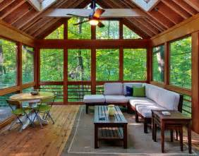 great wooden material in sun room desaign with natural view and pleasant sofa facing large glass