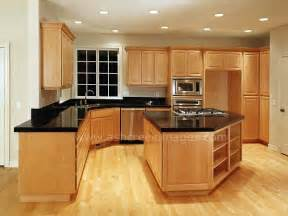 black counter tops and wood floors with the light