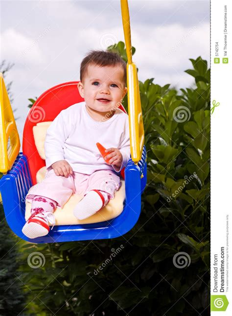 baby on swing baby on a kid swing 1 stock images image 5742754