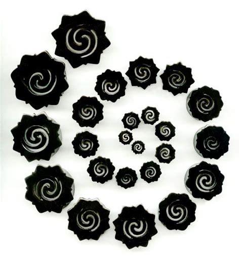 tattoo bunga dayak borneo flares hollow horn plugs with bunga terung dayak