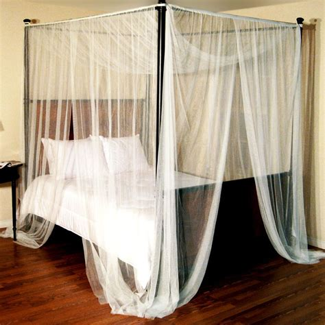 how to hang curtains on a canopy bed enhance your fours poster bed with canopy bed curtains