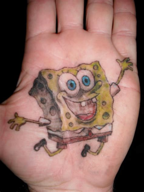 cartoon tattoo on hand inked up cartoon tattoos