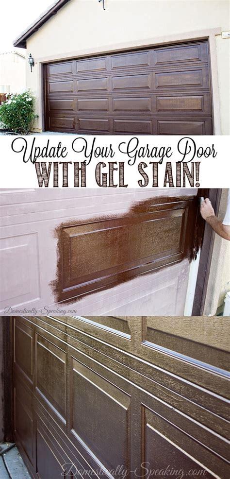 diy garage door makeover  stain domestically speaking