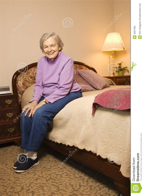 what women want in the bedroom elderly caucasian woman in bedroom stock photography