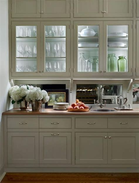 traditional butlers pantry features glass front upper