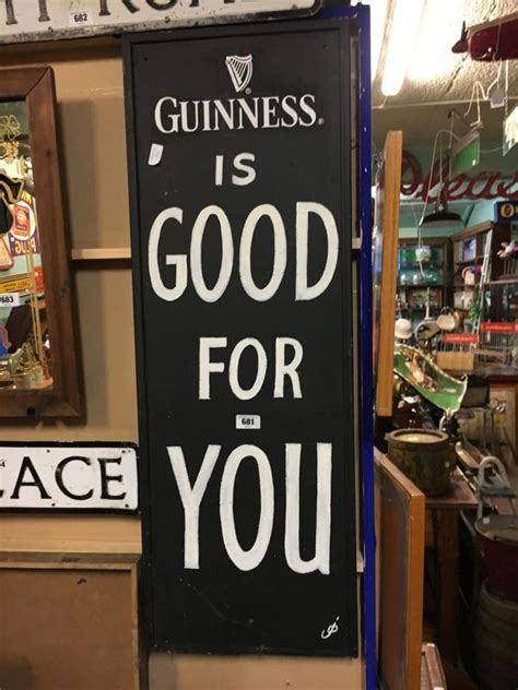 Auction Alert Own A Of Guinnesss Wardrobe by Guinness Is For You Advertisement Painted On Board