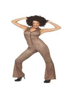 Icon costume includes leopard print jumpsuit with zip down the front