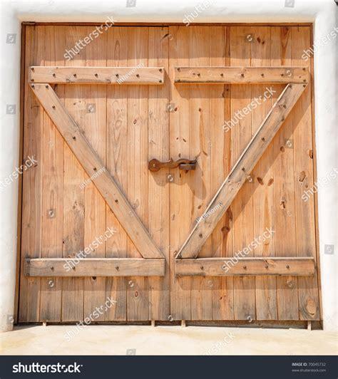 wooden barn doors wooden barn door stock photo 70045732