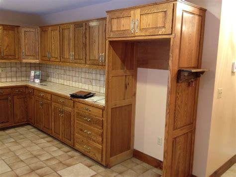 Staining Light Cabinets To by How To Refinish Oak Cabinets