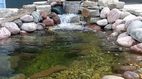 how to make a pond in your backyard how to build a pond in your backyard using stone and river