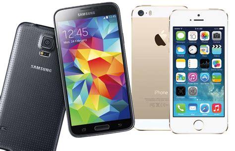 Hp Iphone Vs Samsung samsung galaxy s5 vs apple iphone 5s rival flagships