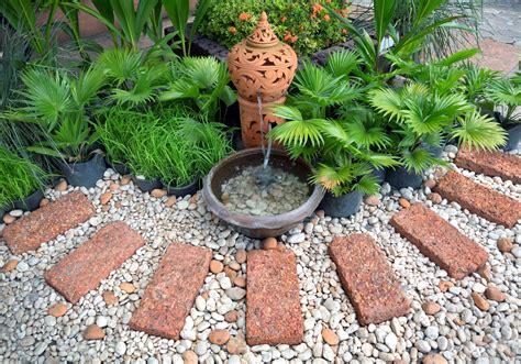 Backyard Pebble Gravel by Garden Design Almost Landscaping
