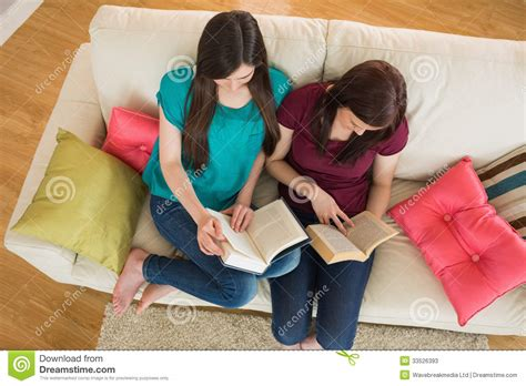 Reading Friends by Two Friends Reading Books On The Stock Photos