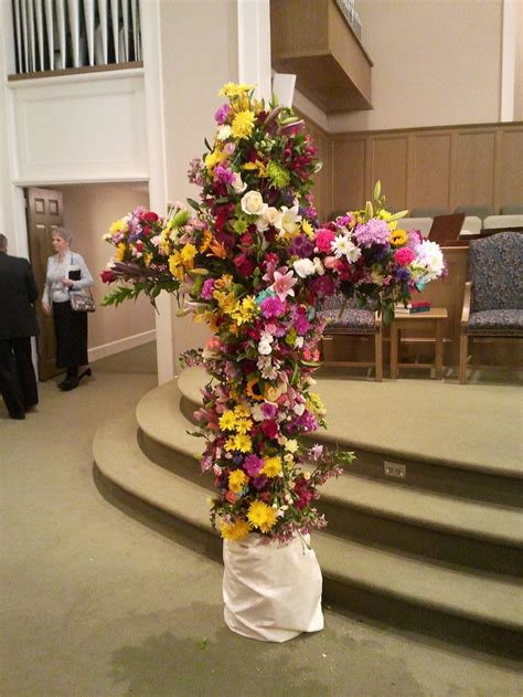 easter sunday service decorations cross covered in flowers after the easter service at my