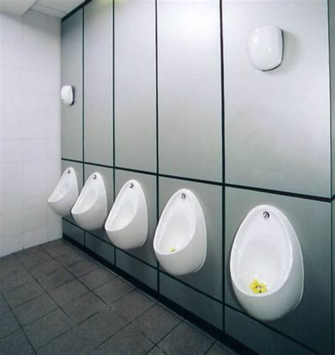 Bathroom Urinals by This Bathroom Has Shoe Guards For The Urinals