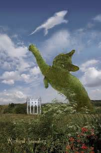 topiary cat the topiary cat is fooled by a mouse shaped cloud when he
