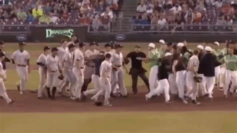 bench clearing baseball dude fires a baseball at point blank range during bench