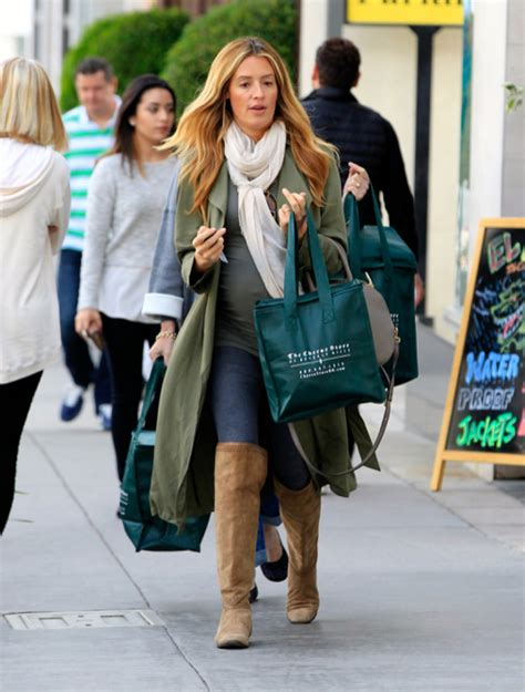 baby laundry hers cat deeley shows baby bump while shopping in