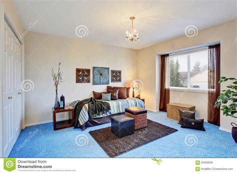 georgous living room with bright blue carpet stock image