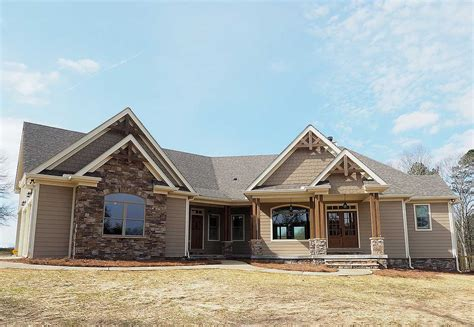 angled craftsman home plan with outdoor spaces 36043dk