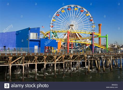 theme park los angeles ferris wheel and a roller coaster in an amusement park