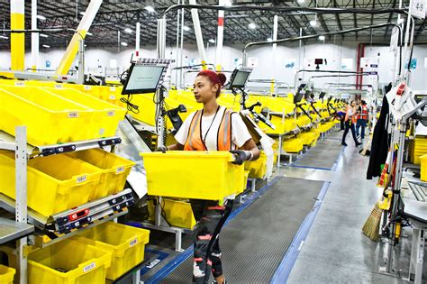 amazon pushes   robots workers find  roles   york times