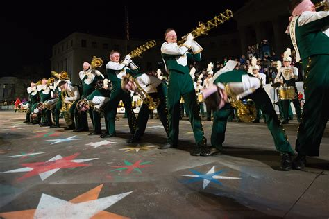 the csu marching band leads the 9news parade of lights