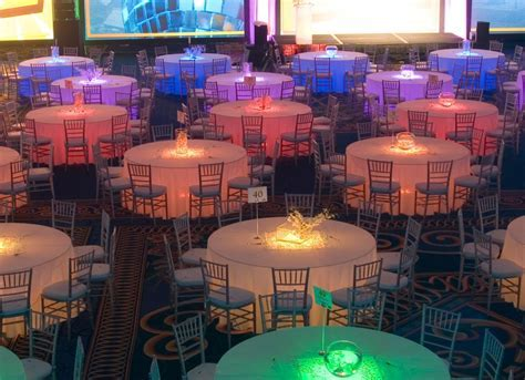 Lighted Tables with pink, orange, yellow, lime, caribbean
