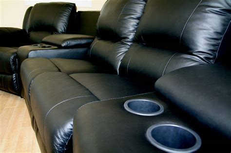 leather reclining sofa with cup holders black leather reclining loveseat homelegance center hill