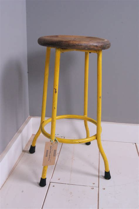 children s yellow metal legged stool with wooden seat