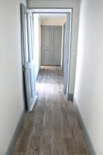 these greyish brown floors plus light blue gray