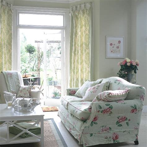 traditional living room with floral sofa and curtains