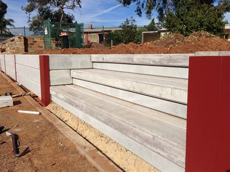 Concrete Sleeper Retaining Wall Installation by Retaining Walls Dirtwork Landscapes Pty Ltd
