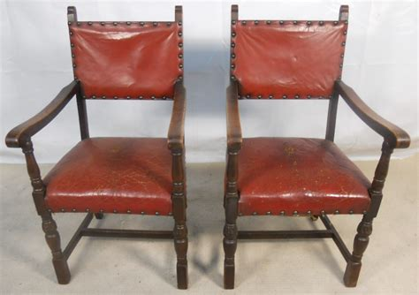 set of six oak frame leather studded dining chairs sold