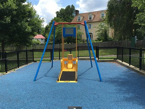 swing for disabled child how can we make playgrounds safe fun for disabled children