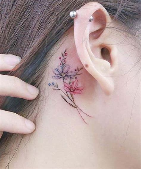 gracefull flower tattoos behind the ear for girls styles