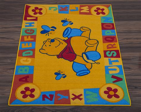 disney rugs official disney educational rug abc winnie the pooh in yellow 95cm x 133cm ebay