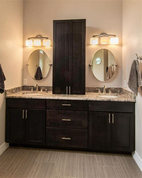 dark brown bathroom cabinets this master bathroom features a double vanity with