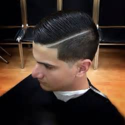 black with haircut and tappered sides tapered with a side part and slicked man hairstyle s