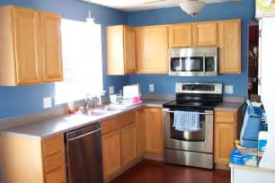 blue walls in kitchen fantatsic light brown kitchen cabinet color with gray countertop plus silver stove and blue wall