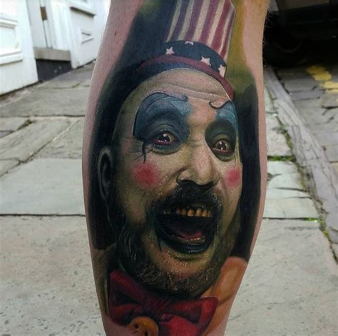 captain spaulding on guy s calf best tattoo design ideas