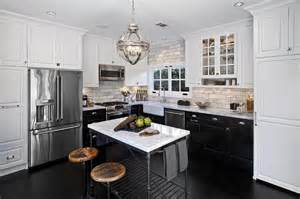 white cabinets and black bottom cabinets with