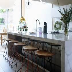 modern kitchen with white marble island modern