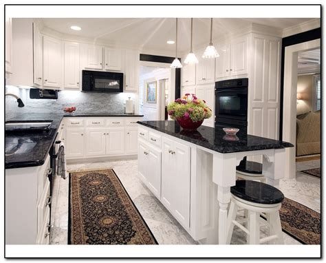 white kitchen cabinets black countertops kitchens with white tile floors images focus on flooring