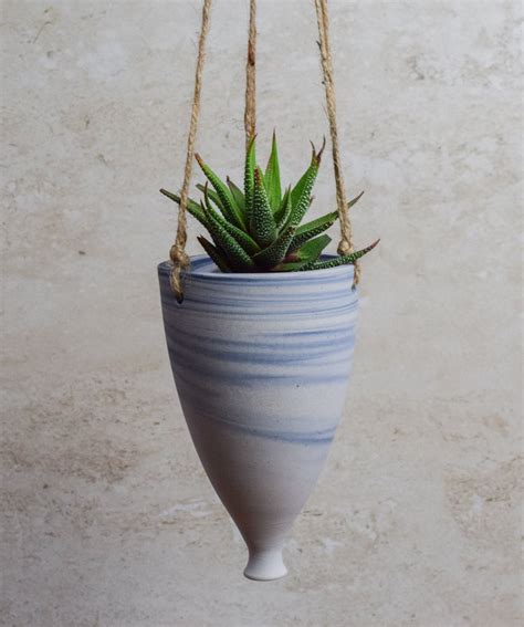 modern hanging planters these 11 hanging planters will inspire you to liven up your home decor contemporist