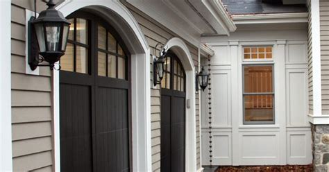 taupe siding  black shutters  doors   home